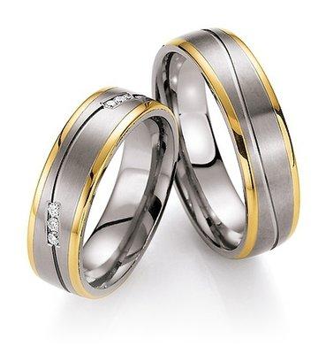 Trouwringen in titanium en geelgoud met diamante(en) per paar