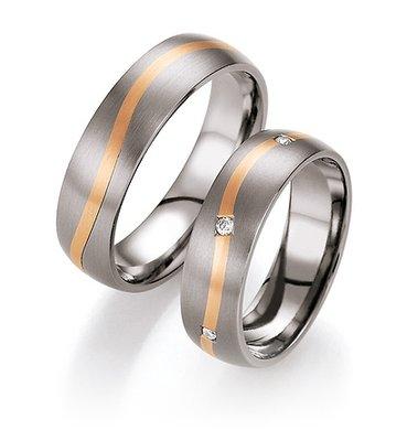 Trouwringen in titanium en roodgoud met diamant(en)per paar