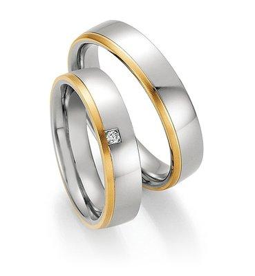 Trouwringen in edelstaal en geelgoud met diamant(en) per paar