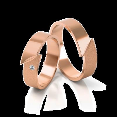 Mooye trouwringen in rosé goud met diamant