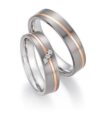 Trouwringen in Titanium en roodgoud met diamant(en) per paar