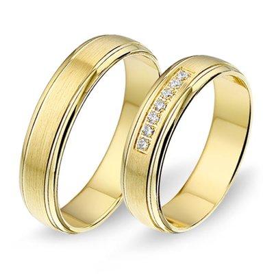 Trouwringen in 8 karaat 333 geel met diamant(en) per paar