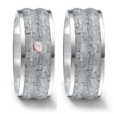 Trouwringen in grijs Carbon, titanium en 18 karaat rosé goud met diamant(en) per paar