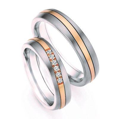 Trouwringen in Titanium en roségoud met diamant(en) per paar