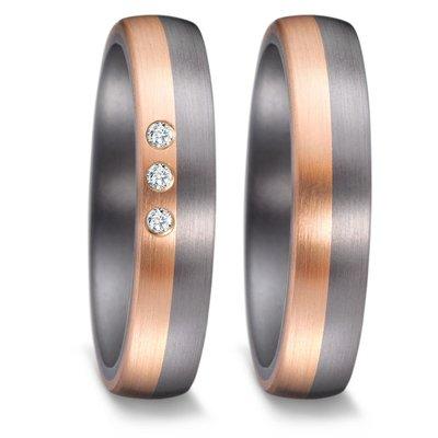 Trouwringen in donkergrijs Tantalium en roségoud met diamant per paar